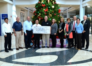 HMMA President and CEO Gui Ill Chun presents a check for 300,000 to representatives from United Way offices throughout the River Region. This is the seventh year Hyundai Motor Manufacturing Alabama has organized a United Way campaign.