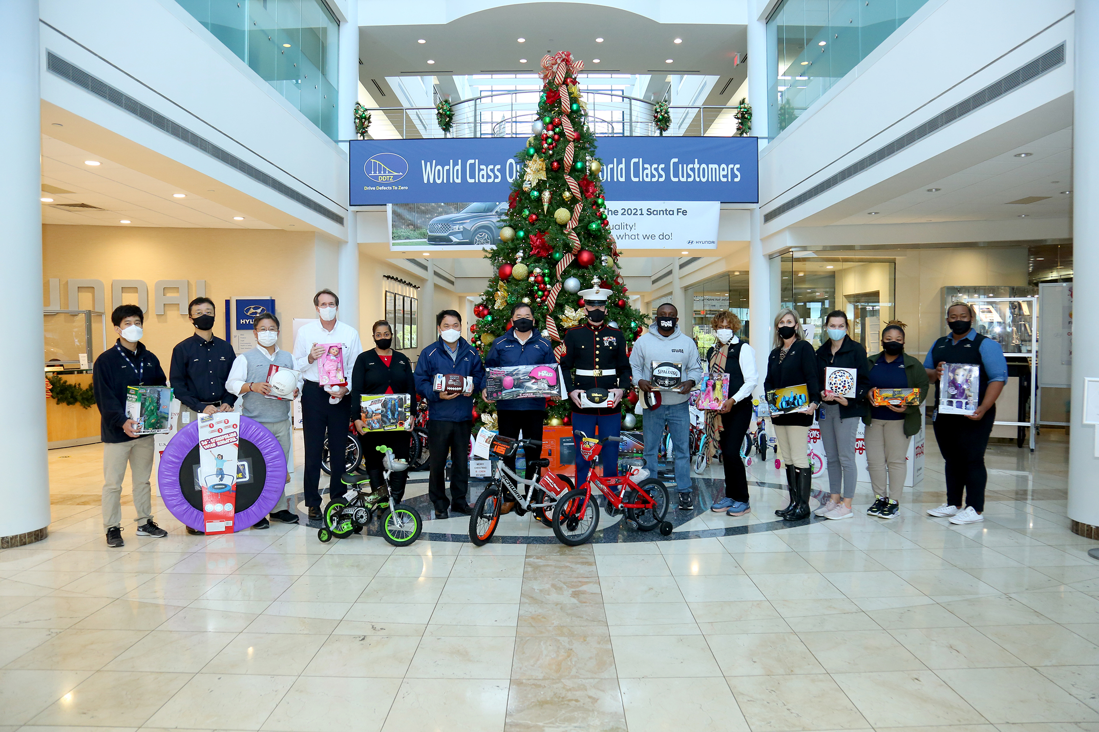 HMMA Team Members Donate Hundreds of Bicycles and Toys to Marine Corps Toys for Tots