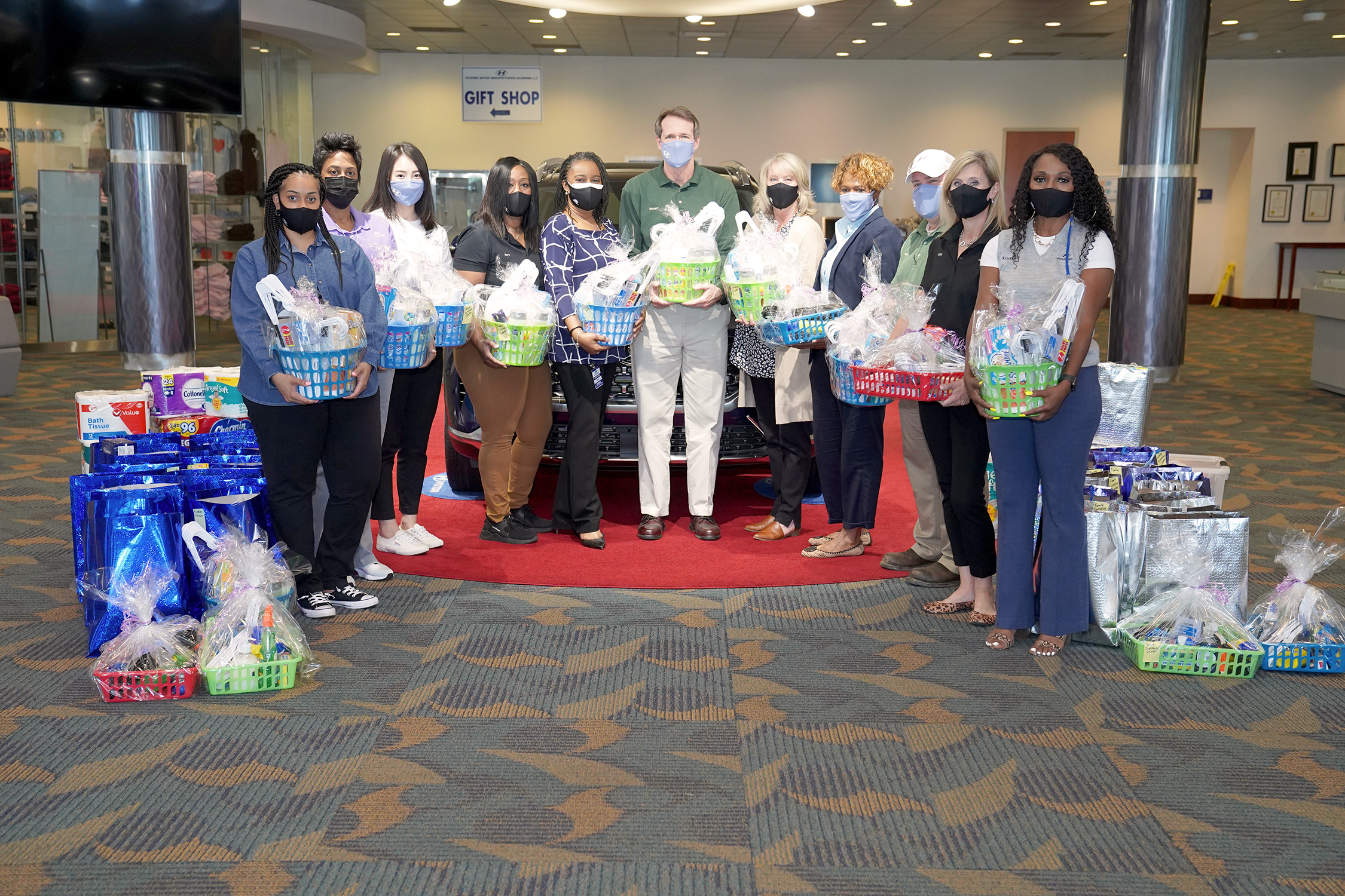 HMMA TEAM MEMBERS DONATE MONEY AND MUCH-NEEDED ITEMS TO LOCAL WOMEN'S SHELTERS